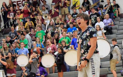 Students cheer on their team in first all school pep assembly of the year